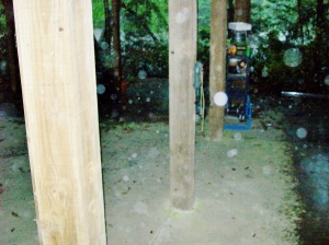 Concrete pad under house, 9AM